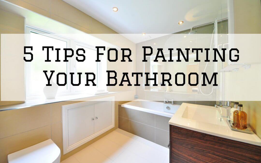 view of freshly painted bathroom in yellow and dark wood